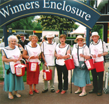 Collecting for Action for Children in the Winners' Enclosure at Windsor Race Course.
