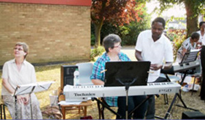 July in the Thames Valley - very hot musicians at an outdoor service
